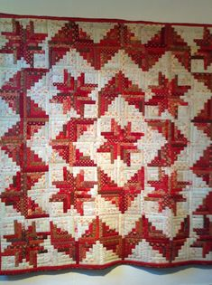 """Log Cabin quilt. I love this log cabin quilt. It has star blocks made of """"logs"""" in between which gives it such a unique look. Very pretty."""