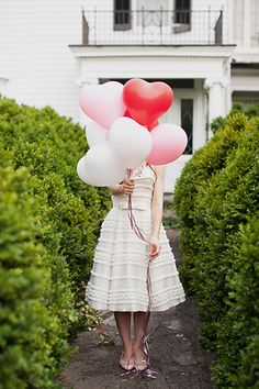 heart-shaped balloons held by the bride // photo by JodiMillerPhotography.com  #heart #wedding