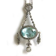 A FABERGÉ AQUAMARINE AND DIAMOND PENDANT  An important turn-of-the-century Fabergé aquamarine and diamond pendant, the pendant comprising an oval faceted aquamarine, within a diamond-set border, with three diamond foliate drops, with diamond surmount and chain, Purchased by dowager Empress Maria Fedorovna of Russia 28/7/12 for 260 roubles.  Circa 1895