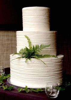 Minimalist White Wedding Cake with Ferns // Follow us on Instagram // #weddingcake #wedding #whitecake #weddingideas