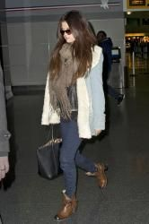 Selena Gomez keeps warm in a thick scarf