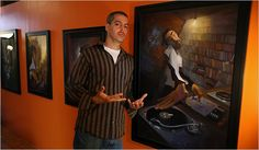 """The artist Justin Bua with his favorite painting, """"The DJ"""" (2001), in a studio in downtown Los Angeles. Credit Monica Almeida/The New York Times"""