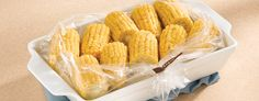 Herbed Corn-On-The-Cob in Microwave: INGREDIENTS  •1 Reynolds™ Oven Bag, Large Size  •1 tablespoon flour  •1/2 cup water  •1/4 cup margarine or butter, diced  •2 tablespoons grated Parmesan cheese  •1/2 teaspoon dried rosemary leaves, crushed  •1/2 teaspoon salt   •1/8 teaspoon pepper  •3 to 4 medium ears fresh or frozen corn-on-the-cob