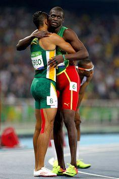 Wayde van Niekerk of South Africa celebrates with Kirani James of Grenada second…