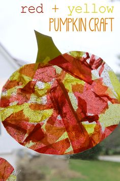 Mixing red and yellow to make an orange pumpkin craft for toddlers