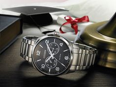 Citizen Men's Dress with stainless steel bracelet and black dial #WatchWednesday