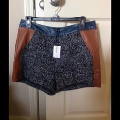 NWT tweed/ leather shorts Perfect for this coming season. Can be worn alone or with fashion tights! Leather and tweed. Size large. Accepting reasonable offers Shorts