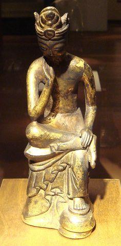 DescriptionPensive Bodhisattva Maitreya made in Baekje 6th century. Gilt bronze, H. 5.5 cm; L.: 5.5 cm. Exhibited at Musée Guimet, Paris.