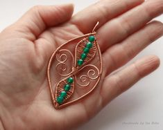 https://flic.kr/p/FHZJCJ | Fleur-de-Lis Pendant no 3 | Wire wrapped Fleur-de-Lis Pendant, Copper with 4 mm green agate beads.