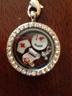 "Perfect gift for the graduate! Nurse Themed Floating Locket with 4 charms 24"" chain included #Locket $17.95 with FREE shipping!"