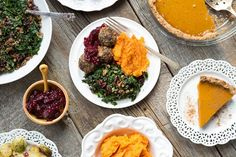 cranberry sauce, baked lentil walnut balls, kale salad, mashed maple cinnamon sweet potatoes, and oat crust pumpkin pie