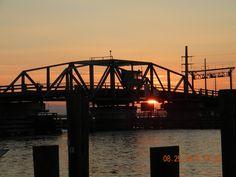 The iconic swing drawbridge between Chincoteague and Marsh Island at sunset.