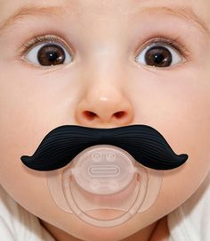 Your baby is cute. You know that, we know that. But is your baby dapper? Mustachifier Baby Pacifier