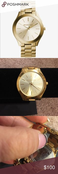 """Michael Kors Slim Runway Goldtone Watch Stainless steel goldtone watch . Good condition, no scratches on the face and the steel looks good as well. This has been sized to fit and I do not have the extra links or the box it came in. When open it measures 10"""" around and 7"""" around when closed. Michael Kors Accessories Watches"""