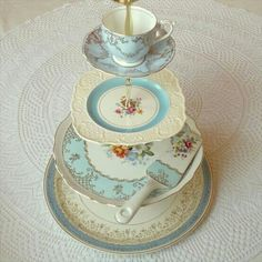 Homemade cake stand from vintage items.  Put large flower in the teacup!