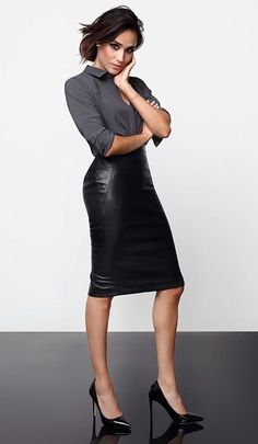 Meghan wearing the Faux Leather Skirt with the grey shirt.