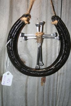 horse shoe with nail cross-SR