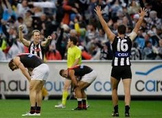 AFL 2012 Rd 05 - Collingwood v Essendon    Nick Maxwell and Nathan Brown of the the Magpies celebrate their win in the AFL Round 05 ANZAC Day match between the Collingwood Magpies and the Essendon Bombers at the MCG, Melbourne. (Photo: Lachlan Cunningham/AFL Photos) AFL Media — at Melbourne Cricket Ground (MCG).