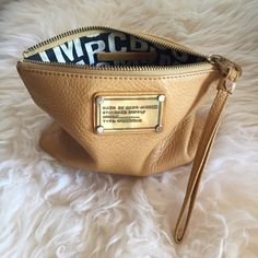 "Marc Jacobs Pouch/Bag Marc Jacobs ""standard supply"" line carry all pouch/wristlet. Perfect for organizing smaller essentials. It could also be a cosmetic bag. Gently used, average wear. 100% Authentic. Marc Jacobs Bags Clutches & Wristlets"