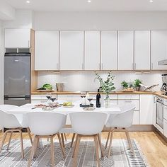 This bright and white Swedish Kitchen looks lovely with the HAY About A Chair. Still one of our favorites.  #whiteout #swedishkitchen #danishdesign #husetshop #aboutachair #interiorinspo