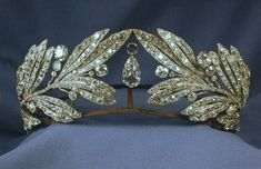 Laurel Leaf Tiara- Queen Sophia of Greece. I like the way this tiara is somehow opposite of the usual lines, which seem to flow from the center and down. Here each side reaches in, not meeting, but creating a vacuum for the large, pear shape diamonds. Royal Crowns, Royal Tiaras, Crown Royal, Tiaras And Crowns, Antique Jewelry, Vintage Jewelry, Queen Sophia, Diamond Tiara, Diamond Pendant