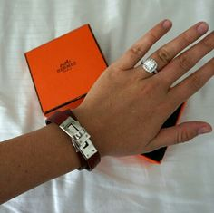 NEW PHOTOS Hermes Kelly Double Tour Bracelet Comes with orange box and brown jewelry bag. Minimal scratches on hardware, red leather looks perfect, some discoloration on the inside from wear, this bracelet has been loved. Size small - fits a very petite wrist. Marked N in square and R. No trades, no lowball offers. I can email high res photos upon request. Last photo shows the red color best! Hermes Jewelry Bracelets