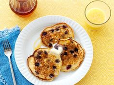 For a tangy twist on blueberry pancakes, Ree adds fresh lemon juice and zest to the batter. Stir in blueberries for a fruity flavor and a pop of vibrant indigo color.