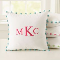 monogrammed initials on pillow with pom pom edging