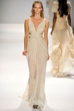 Such a simple yet beautiful dress! Love the cut outs on the sides