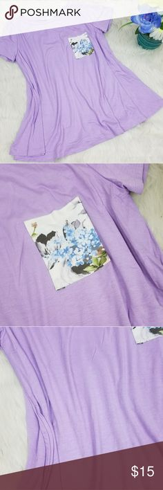 """Stunning T-Shirt Beautiful lavender flowy T-shirt with cute floral front pocket. Super cute great for summer.  Bust Roughtly 15""""  Let's Keep in touch!<3 IG: Gypsy_Road Twitter: Gypsy_RoadBTQ Facebook: @GypsyRoadBTQ  any questions or concerns Please email us at  Gypsyroadbtq@gmail.com Tops"""
