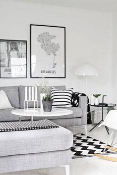 salón en tonos blancos grises y negros