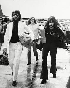 Ringo Starr and Maureen Starkey wearing bell bottoms and a star print shirt
