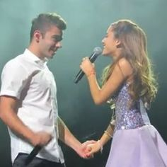 Ariana is singing to Nathan!!!! They are holding hands!!!!! :)