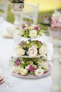 3-tier floral centerpiece stand from Laduree Tea Party at Kara's Party Ideas. See the gorgeous details at karaspartyideas.com!