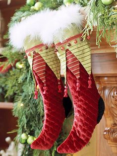 Add a festive flair to these traditional red and green Christmas stockings by embellishing them with feather trim. Christmas Mantels, Noel Christmas, Green Christmas, Christmas Decorations, Green Stockings, Xmas Stockings, Velvet Christmas Stockings, Whimsical Christmas, Beautiful Christmas