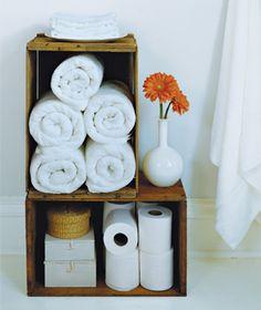 Use a wooden crate [or any kind of bin] to store extras in the spare bathroom, so guests don't have to go hunting for the linen closet.