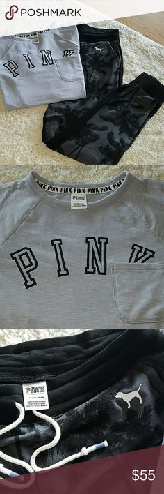 Pink Victoria secret joggers/shirt, sm oversized Pink Victoria secret joggers/shirt, sm oversized fit, could fit med too....top is a grayish blue, with Pink in black, bottoms are black with the colors of the shirt and palm tree design on the front, black on the back with pockets on the front. Excellent condition! PINK Victoria's Secret Tops