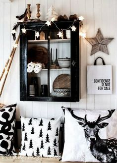 A different take on holiday decor. Instead of the traditional red and green, play with black and white instead! Very modern and chic look for the holidays.