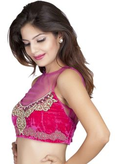 A pink velvet blouse with sheer net neckline, embellished with royal 'zardozi' motifs Accentuated with dull gold 'zari'