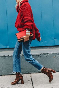 Autumn street style. Over sized red turtle neck jumper with raw hemmed blue jeans and snake-skin block heel boots