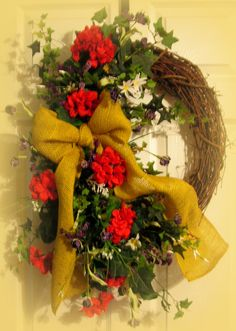 "Spring and Summer wreath, Reds, Yellows and    White....30"" in height from top of greenery to bottom of greenery...also a burlap bow...it is Very welcoming.....$49.99"