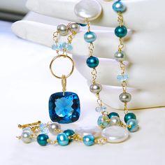 A personal favorite from my Etsy shop https://www.etsy.com/listing/508208914/topaz-biwa-aqua-pearls-and-blue-quartz