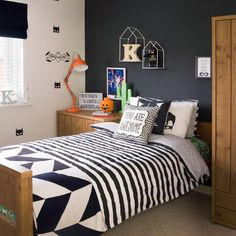 Teen's bedroom with feature grey wall and monochrome bed linen