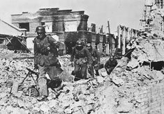 """German infantry cross a sea of ruins in the """"Barricades"""" factory in Stalingrad, end Oct 1942. The German decision to fight a battle inside the necropolis was fatal."""