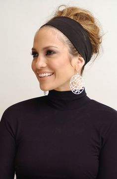 For a Monster-in-Law press conference in Jennifer pulled her hair back with  a thick black headband and teased and tousled her ends. ebf3959f1d7