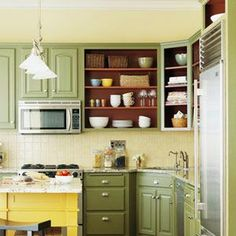 Simple kitchen update: remove doors from one or more cabinets, for an extra pop paint the back of the cabinet!