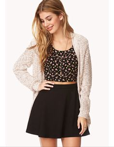 A classic black skater skirt with a floral print top and a roasted marshmallow colored cardigan is simple yet chic. Love.