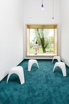 Kindergarden in Chroscice (Poland) designed by PORT | Deep window sills for inhabiting + hanging lights