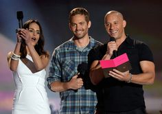 Jordana Brewster and Paul Walker Photos Photos - (L-R) Actors Jordana Brewster, Paul Walker, Vin Diesel and Michelle Rodriguez speak onstage during the 2013 MTV Movie Awards at Sony Pictures Studios on April 14, 2013 in Culver City, California. - 2013 MTV Movie Awards Show