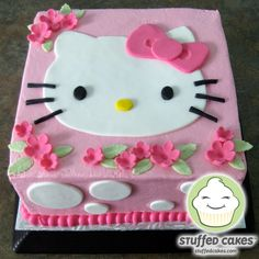Her cute face is the star of this cake and she's surrounded by flowers and polka dots. Any Hello Kitty lover would love this cake!